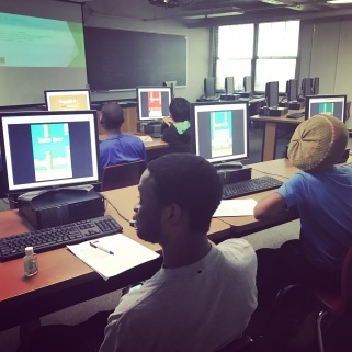 Students designing their games by checking out some failed Flappy Bird designs!